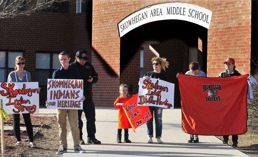 """People who support keeping the """"Indians"""" sports mascot for Skowhegan schools gather April 13 at the Skowhegan Middle School to express their opinion."""
