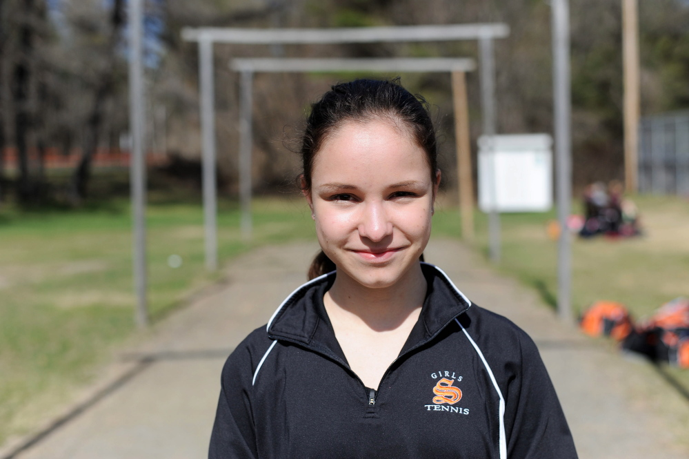 Staff photo by Michael G. Seamans Skowhegan Area High School's Vasilisa Mitskevich prepares for a tennis match in Skowhegan last week. The Russian exchange student plays No. 1 singles for the Indians.