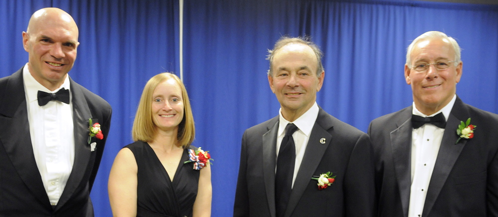 Staff photo by Andy Molloy Eric Weinrich, left, Marcie Lane Schulenberg, William Alfond and Glenn Dumont were inducted into the Maine Sports Hall of Fame on Sunday at the Augusta Civic Center.