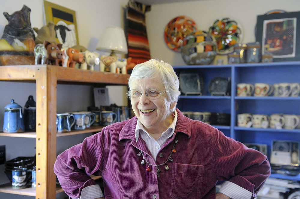 Barbara Loken greets guests Sunday at her pottery studio, located behind her Farmingdale home. Loken Pottery was open for tours during the Maine Pottery Tour, along with several other shops in Maine.