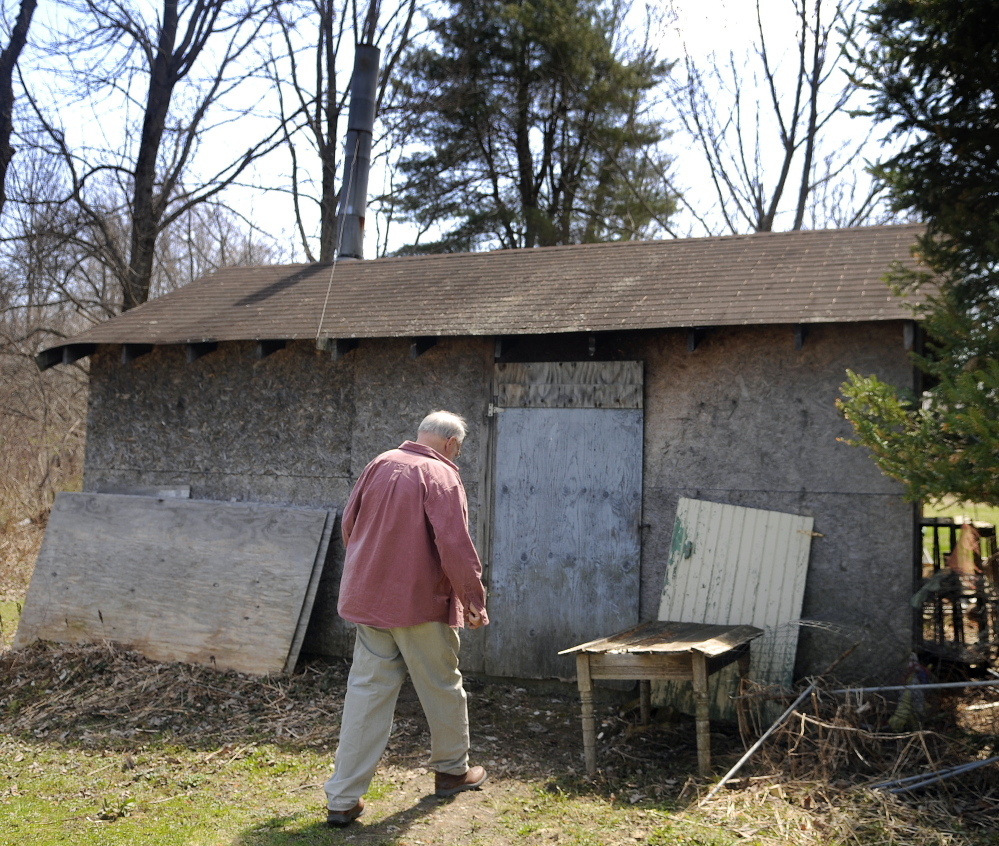 Neal Loken heads to the gas-fired kiln building Sunday at the pottery studio behind his Farmingdale home. Loken Pottery was open for tours during the Maine Pottery Tour, as were several other shops in Maine.