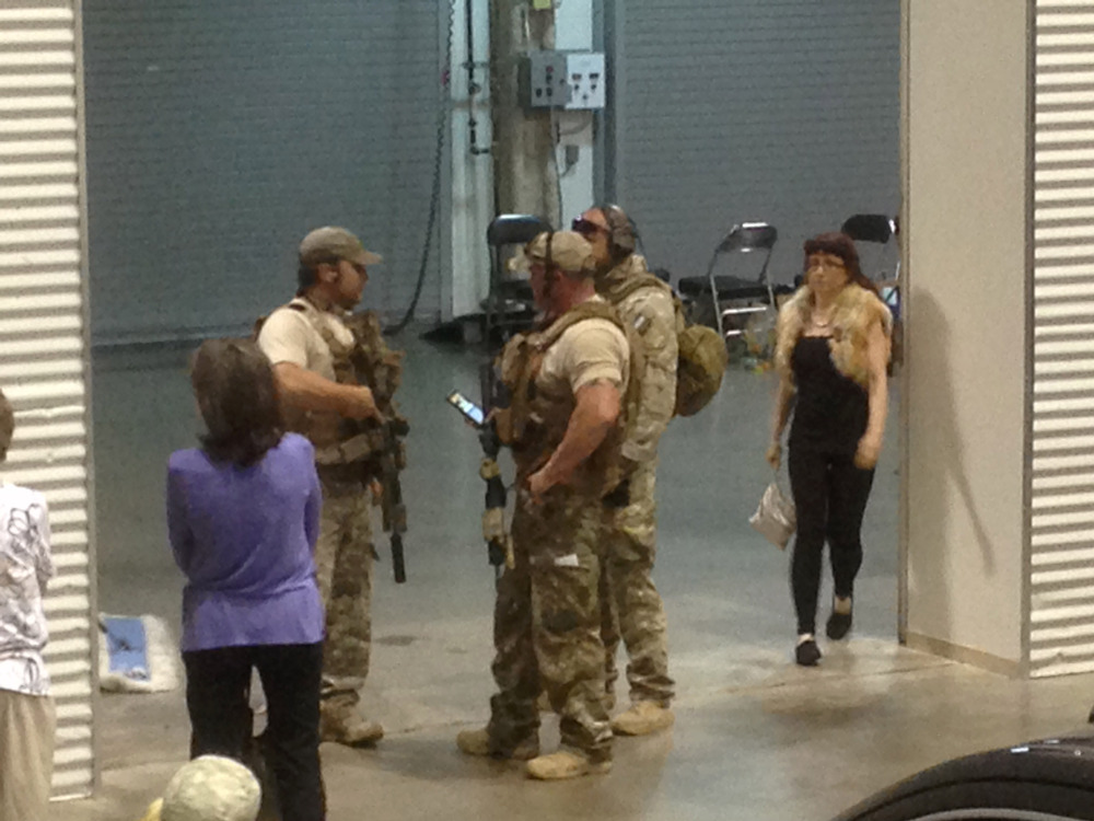 Members of the Garland Police Department stand inside the Curtis Culwell Center, Sunday in Garland, Texas.