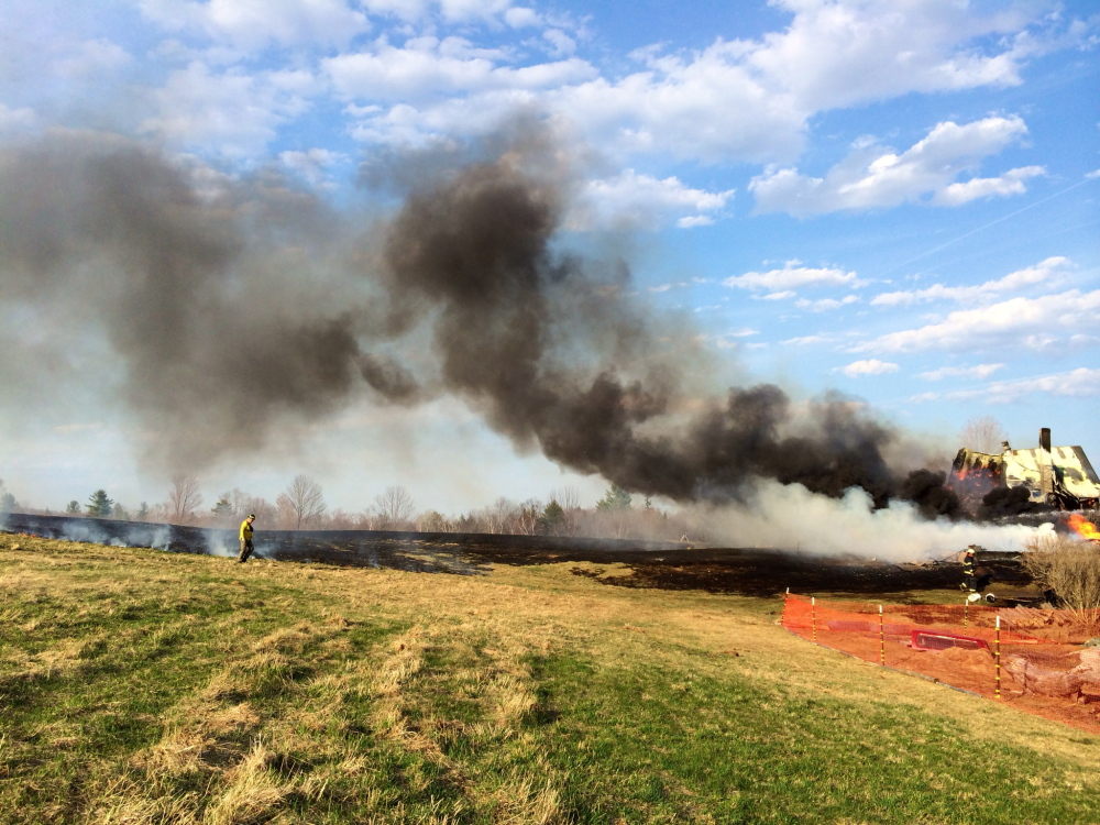 A fast-moving fire in a house in Solon was threatening to spread to an adjoining field late Monday afternoon.