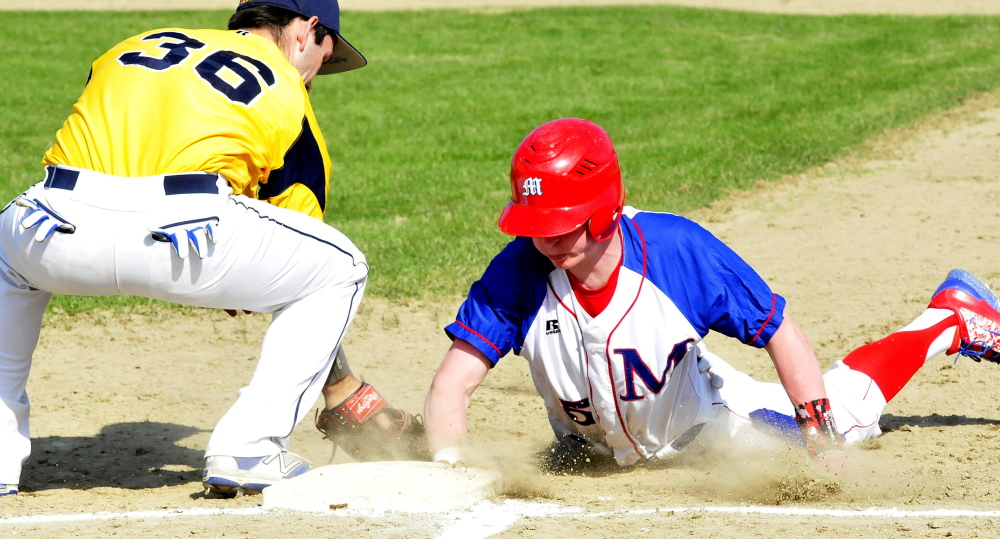 Messalonskee's Trevor Getting just slides back to first base safely as Mt. Blue's Corey Rogers attempts applies a tag during a Kennebec Valley Athletic Conference Class A game Monday afternoon.