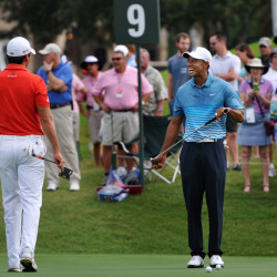 Tiger Woods, right, chats with Jason Day on the ninth green Tuesday during a practice round for The Players Championship in Ponte Vedra Beach, Fla.
