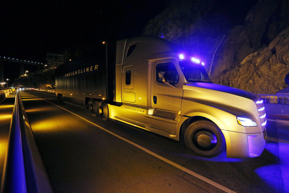 Freightliner unveils its Inspiration self-driving truck during an event at the Hoover Dam Tuesday near Boulder City, Nev.