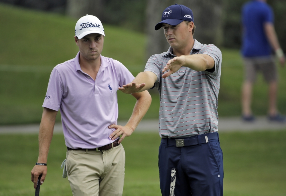 Jordan Spieth, right, explains the break on the 15th green to Justin Thomas during a practice round Wednesday at The Players Championship in Ponte Vedra Beach, Fla.
