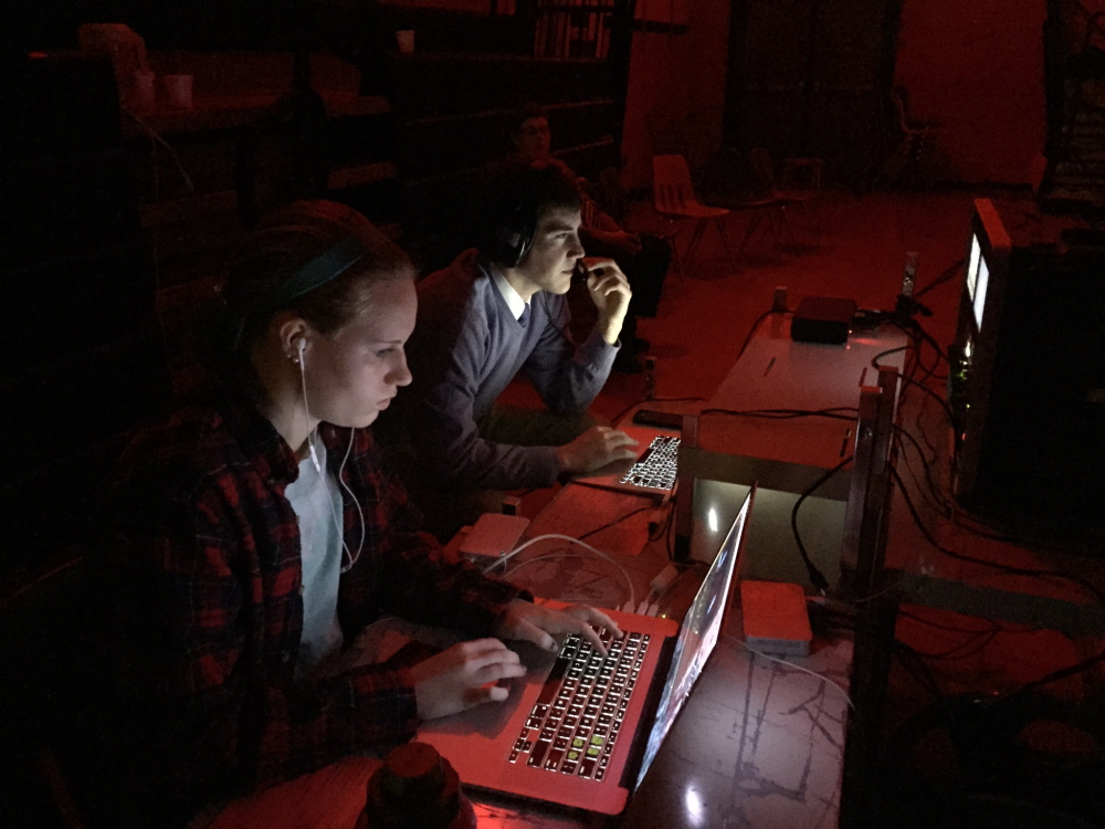 Emma Hickey, a senior at Gardiner Area High School, works on the video production of the school music department's annual Pizazz Concert in March.