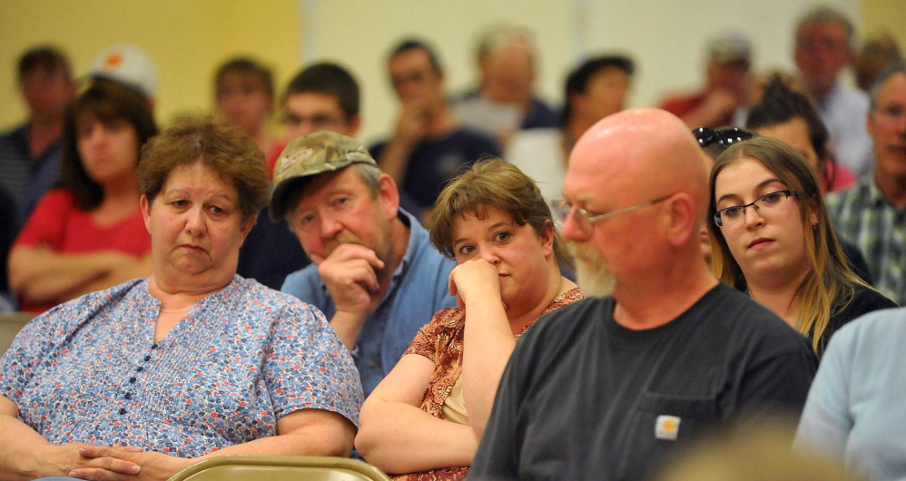 Skowhegan area residents listen to the SAD 54 School Board during a board meeting at Skowhegan Junior High School Thursday night. The name change was voted down.