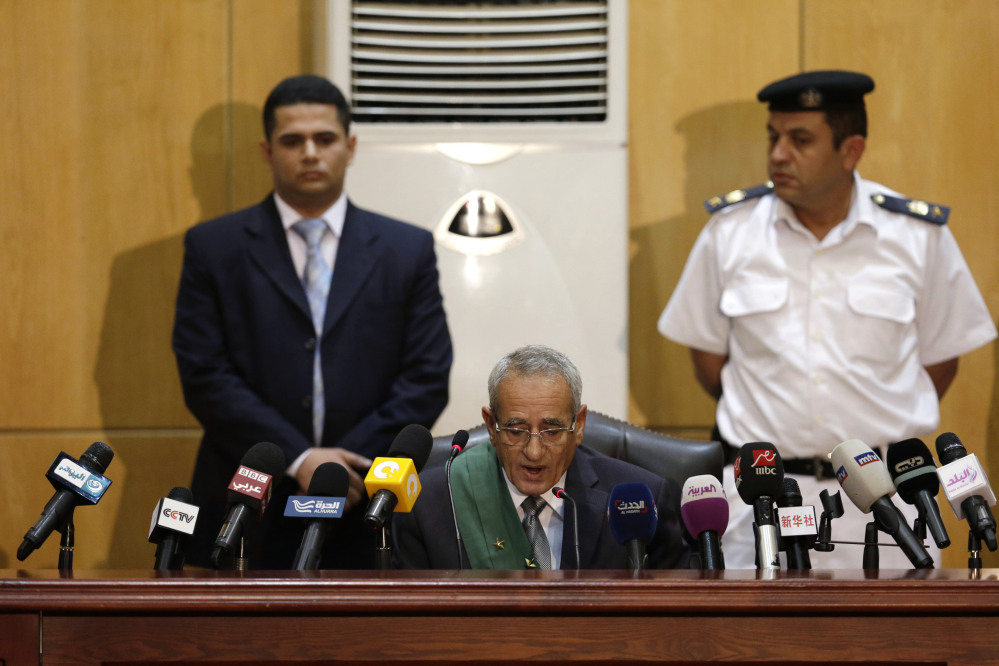 "Egyptian Judge Hassan Hassanin reads the verdict of the corruption case dubbed by the Egyptian media as the ""presidential palaces"" affair concerning charges that former Egyptian President Hosni and his two sons Gamal and Alaa Mubarak, embezzled millions of dollars' worth of state funds over the course of a decade in a courtroom in Cairo, Egypt, on Saturday."