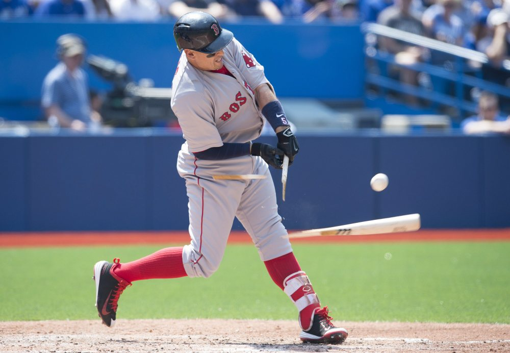 Boston Red Sox' Allen Craig shatters his bat while popping out during fourth inning of Saturday's game against the Toronto Blue Jays in Toronto. The Blue Jays won 7-1.
