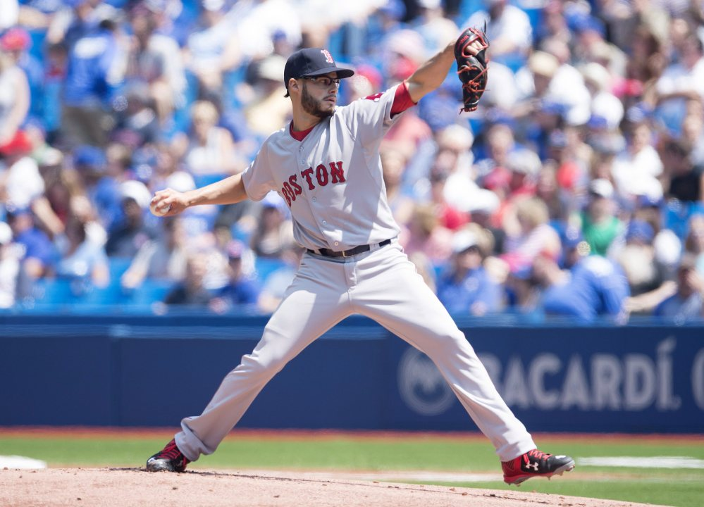 Boston Red Sox starting pitcher Joe Kelly works against the Toronto Blue Jays during first inning of Saturday's game in Toronto. The Blue Jays won 7-1.