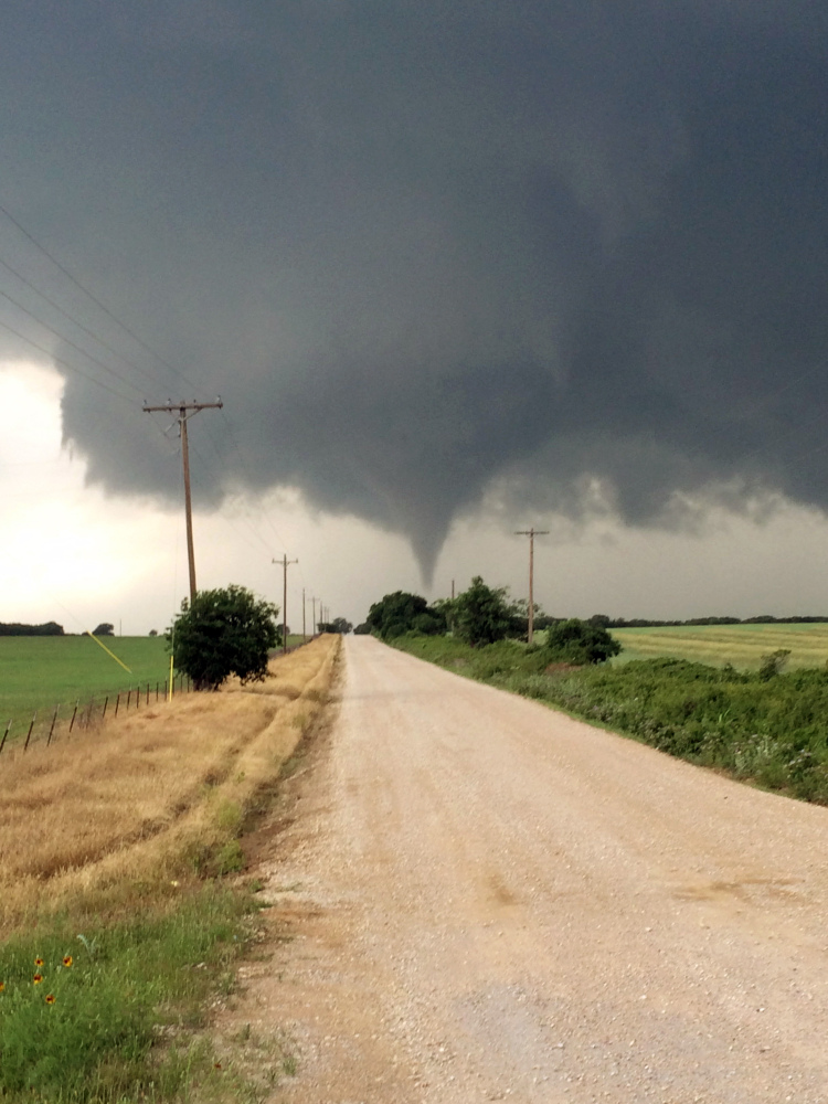 In this Saturday photo provided by Brian Khoury, a tornado touches down in Cisco, Texas.