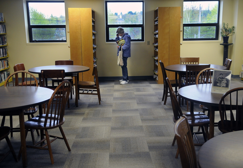 A woman browses at the temporary location of Augusta's Lithgow Public Library that opened Monday for what's expected to be an 18-month stint at the Ballard Center on Augusta's east side.