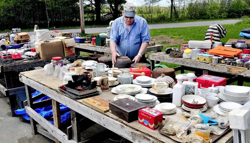 The Cornville 10-Mile Yard Sale opens for its 32nd year on Saturday, bringing treasure seekers together with vendors such as Philip Goodell of Cornville, seen in this file photo setting up his merchandise for the 2012 sale at his home on the West Ridge Road in Cornville.