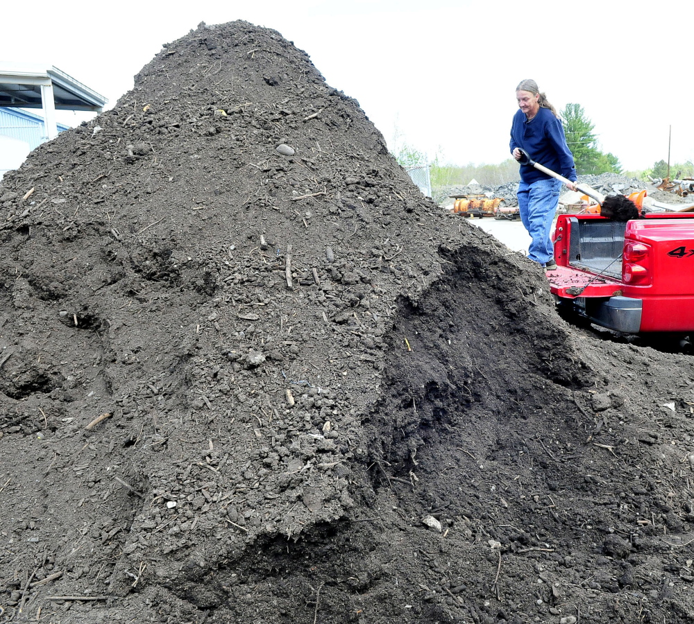 Heather Enos fills her truck bed on Wednesday with compost made at the Skowhegan Regional Recycling Center and made available for residents.