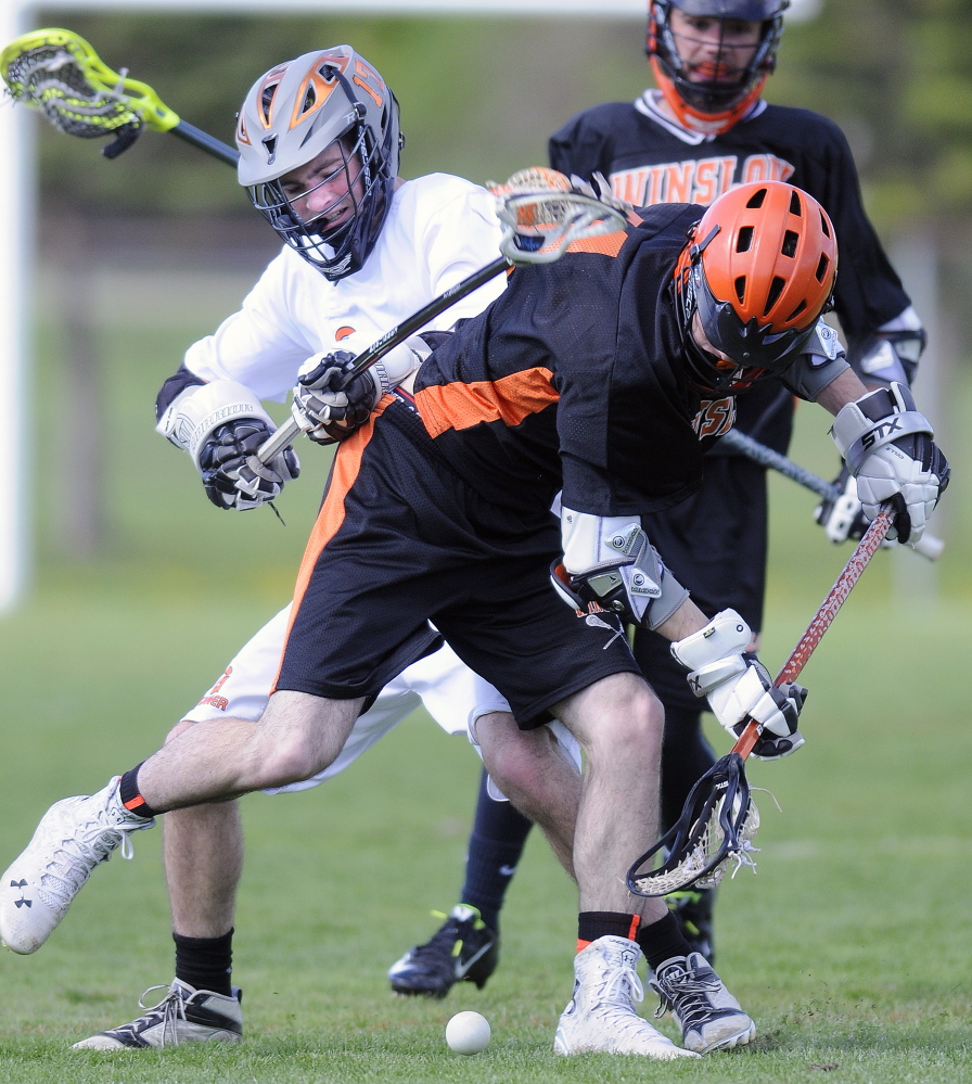 Gardiner Area High School's Cam Bell, left, collides with Winslow High School's Jacob Houghton during a lacrosse game Wednesday in Gardiner.
