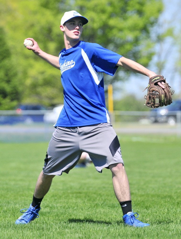 Ryan Rodrigue plays catch during Erskine Academy baseball practice Thursday in South China.