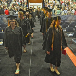 Lindsey Adams, left, and Mellissa Arroyo lead graduates into the Kennebec Valley Community College graduation ceremony on Saturday at the Augusta Civic Center.