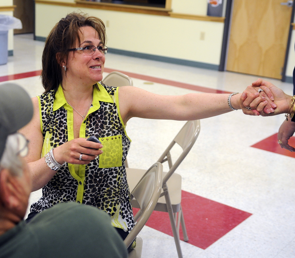 Rhonda Smith, of Wayne, greets another member of the Capital Area Lyme Support Group during their monthly meeting in Manchester.