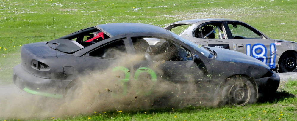 Racer John Roach spins off the track after blowing a front tire during the Super Stock Enduro race Sunday at Unity Raceway.
