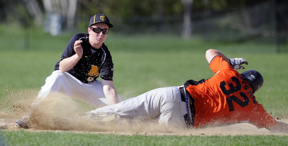 Gardiner Area High School baserunner Brad Weston beats the tag of Maranacook second baseman Matt Gyorgy at second during a game Monday afternoon in Readfield.