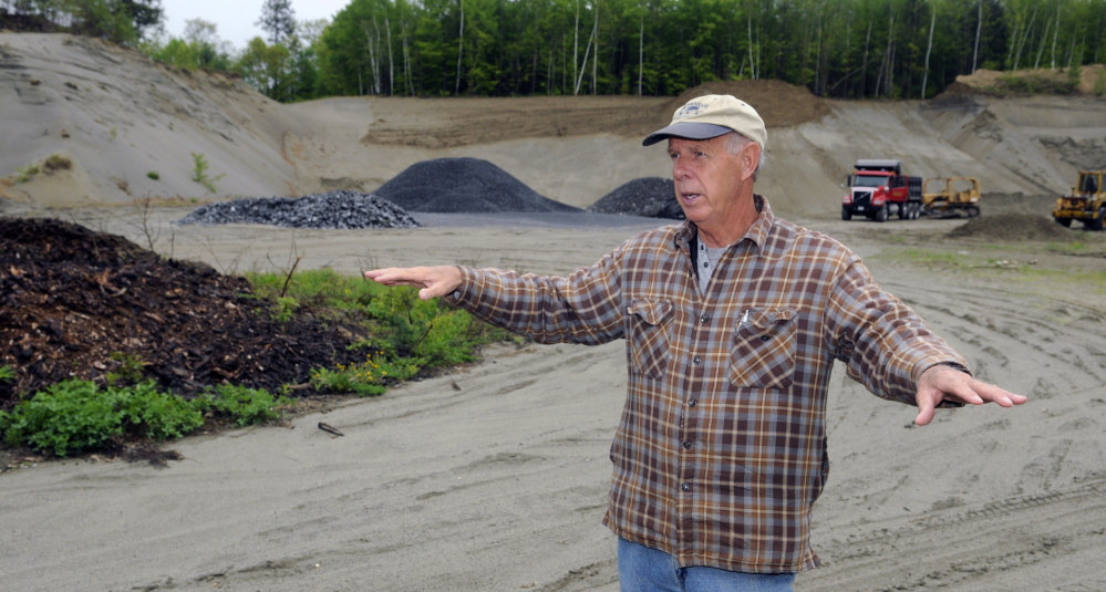 Belgrade Board of Selectpersons Chairman Ernie Rice stands on the site of a proposed new Town Office on Tuesday. The site is on Route 27 and is now a sand pit.