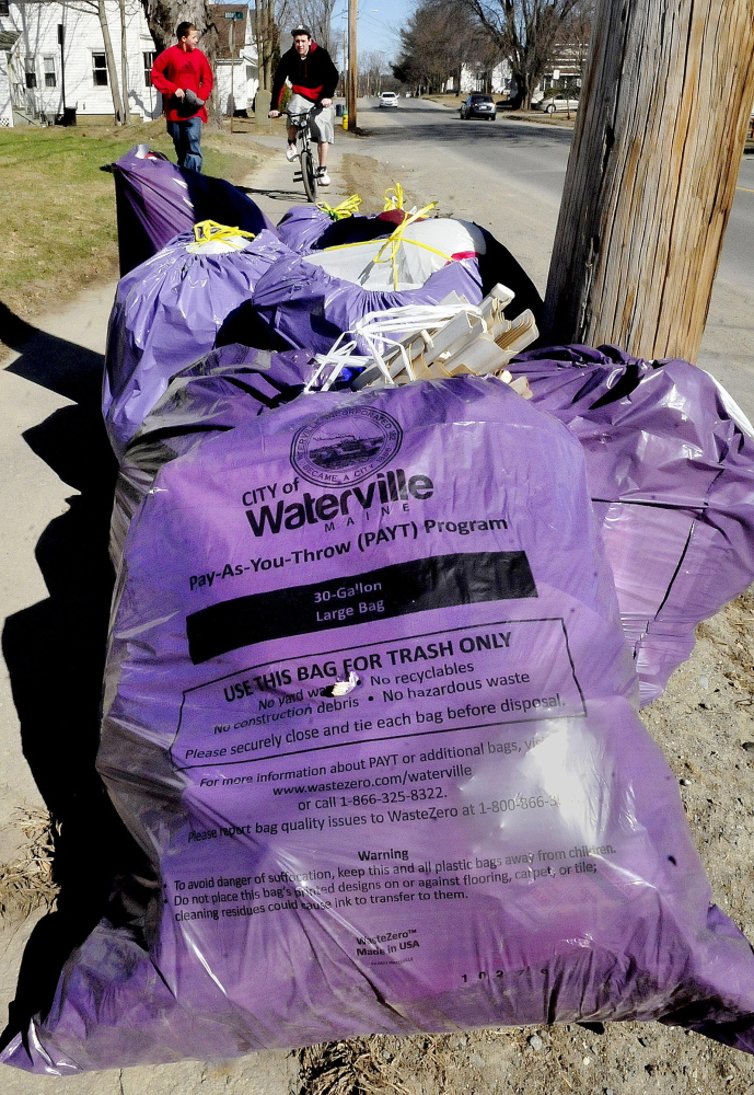 Waterville garbage bags sit curbside in April waiting for pickup. The City Council on Tuesday night discussed forming a solid waste committee to handle issues associated with the city's garbage pickup.
