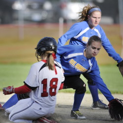 Mount Abram's Abby Holland, right, and Bailey Beers chase a throw to second base that struck Hall-Dale runner Eva Shepherd during a Mountain Valley Conference game Wednesday.