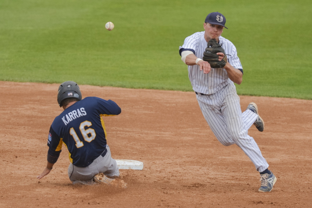 University of Southern Maine shortstop Sam Dexter makes the turn on an inning-ending double play during the second inning of a game against Emory University in the Division III College World Series last year. Dexter, a Messalonskee graduate, was named the D3baseball.com national player of the year.