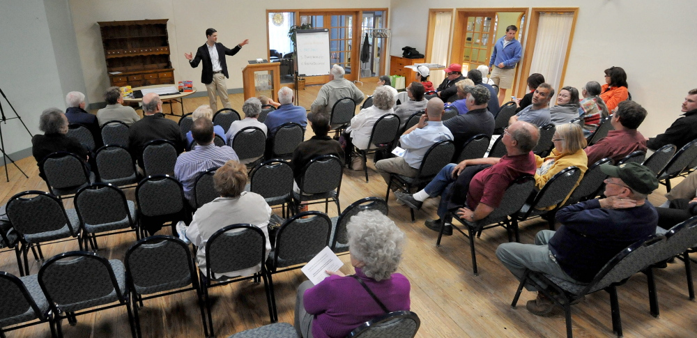 Waterville Mayor Nick Isgro opens a forum Wednesday to educate people on what can be recycled and various types of trash bags available with the pay-as-you-throw trash and recycle program at The Center in Waterville.