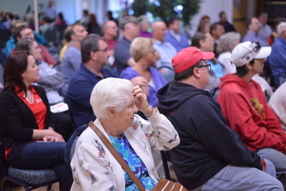 Waterville residents gather for a pay-as-you-throw forum Wednesday at The Center in Waterville. The forum was organized by city officials to educate residents on what can and cannot be recycled and various types of trash bags that can be used with the program.