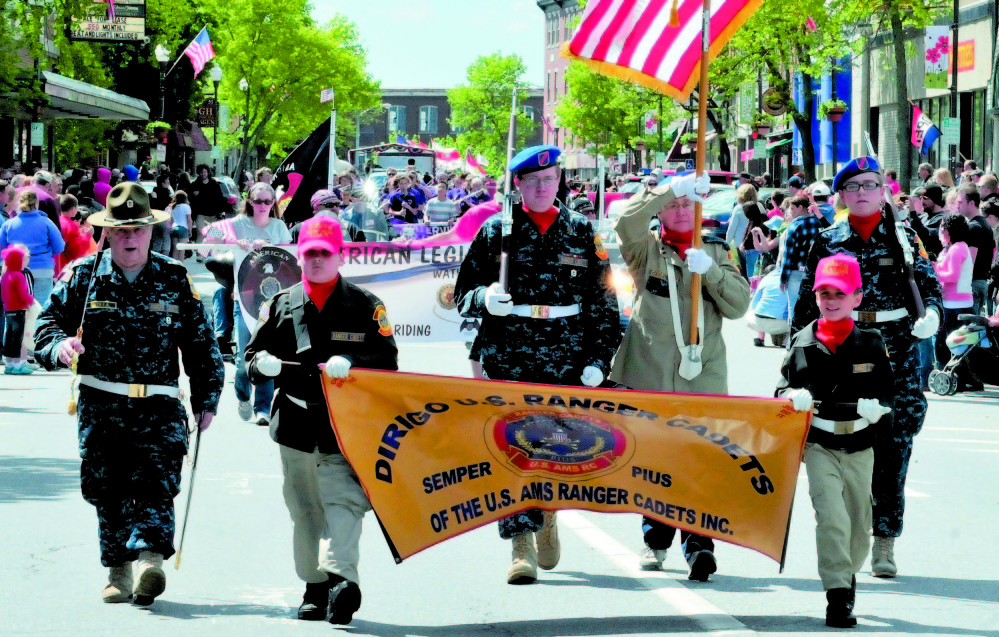 Members of the Dirigo U.S. Ranger Cadets joined veterans organizations, marching bands, fire departments and other groups during the 2013 Memorial Day paraade through downtown Waterville. Marchers gather for Monday's parade at 10 a.m. at Head of Falls and will proceed south on Front Street, then north on Main Street. The streets will close 15 minutes before the parade begins.