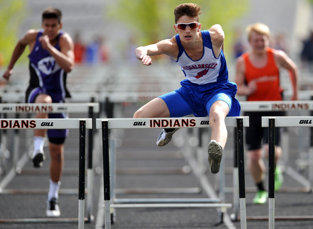 Staff photo by Michael G. Seamans Messalonskee High School's Tanner Burton leads the 100 meter hurdles at the Community Cup track and field meet Thursday in Skowhegan.