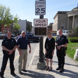 From left, are Officer Damon Lefferts, Police Chief Joe Massey, June L'Heureux, office manager, Waterville Main Street; and Officer Chase Fabian.