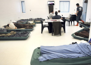 Inmates watch television recently in an overcrowded pod at the Kennebec County Correctional Facility in Augusta. Men incarcerated there often sleep on the floor because of a lack of space.