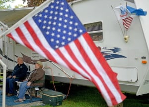 Lenny and Susan Turcotte, of Portland, relax on Friday in front of their camper at Two Rivers Camp Ground in Skowhegan. The couple makes about eight camping trips a year.