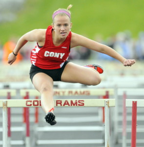 Staff photo by Joe Phelan Cony's Madeline Reny wins the 100-meter hurdles during the Capital City Classic on Friday at Cony High School in Augusta.