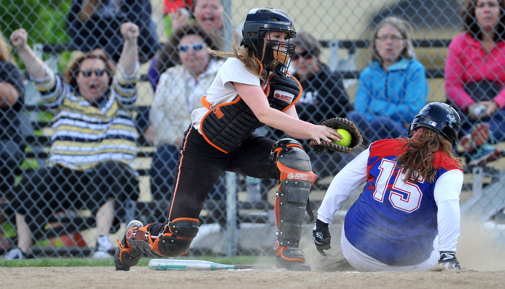 Skowhegan Area High School catcher Gabby Sirois can't get the tag applied to Messalonskee High School's Ali Pearl (15) on Friday at Skowhegan Area High School. Messalonskee won 3-2 in eight innings.