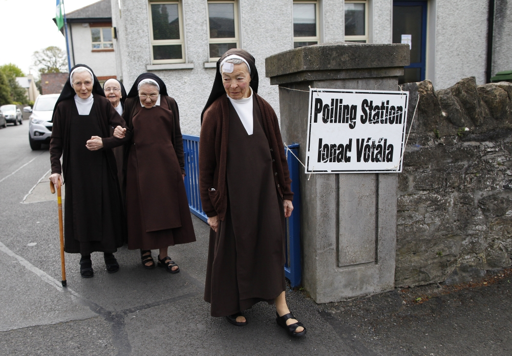 Carmelite sisters leave a polling station in Malahide, County Dublin, Ireland, Friday.
