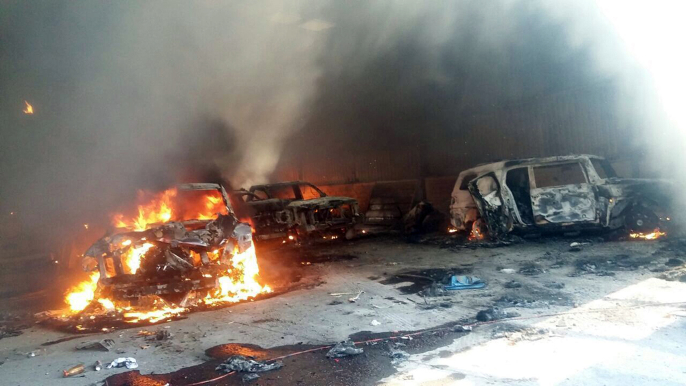 Vehicles burn, that authorities say caught fire during a gunbattle, in a warehouse at Rancho del Sol, near Ecuanduero, in western Mexico, Friday.