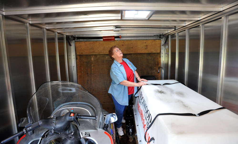 Betty Reckards, a volunteer EMT/firefighter with the Rockwood Fire Department, stands inside a trailer with a specialized rescue sled in Rockwood. Because of the remote nature of the department and its coverage area, the sled is often necessary to move victims from accident scenes.