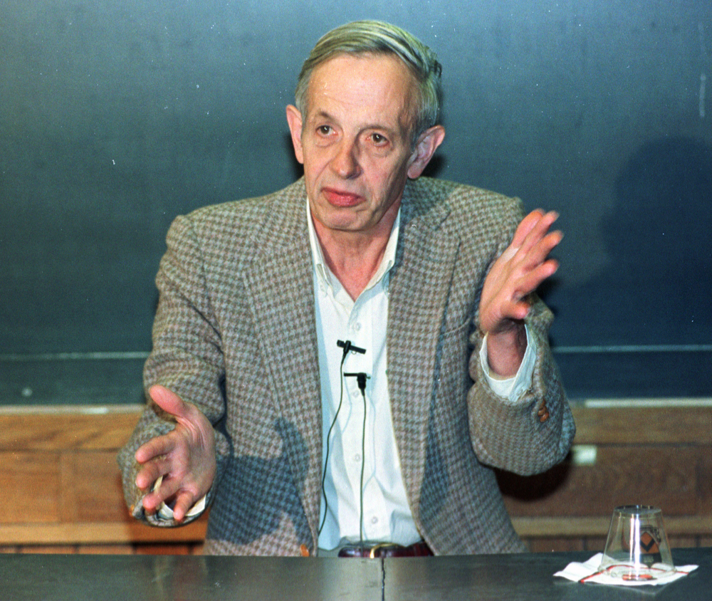 In this Oct. 11, 1994 file photo, Princeton University professor John Nash speaks during a news conference at the school in Princeton, N.J., after being named the winner of the Nobel Peace Prize for economics.