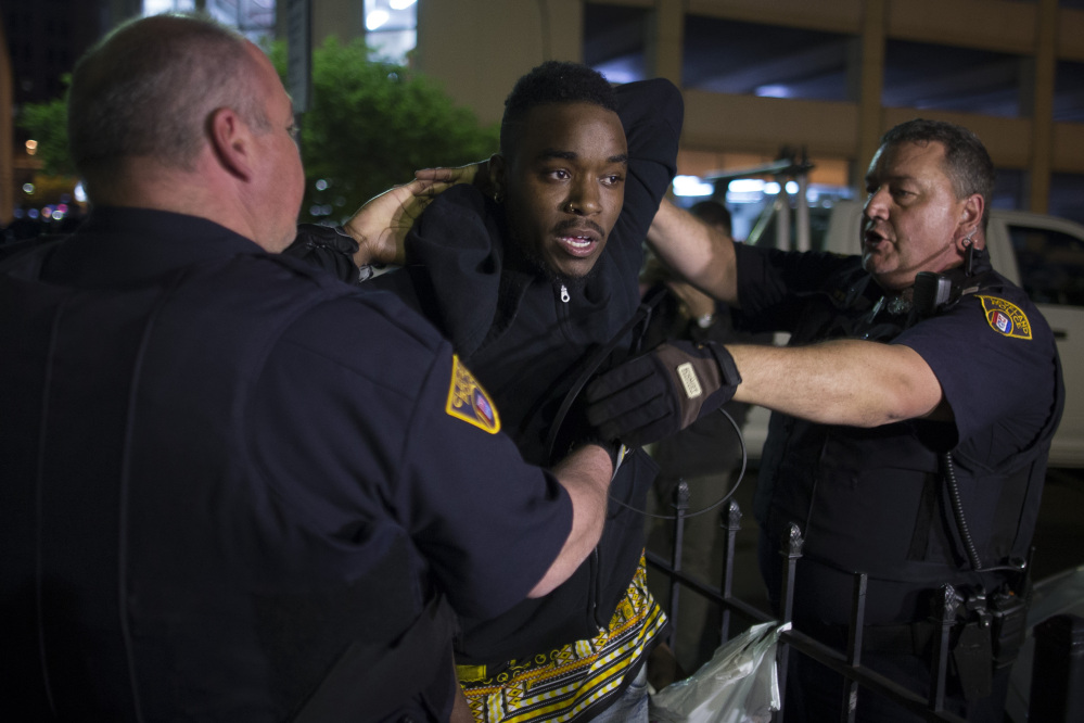 The Associated Press A demonstrator is arrested during a protest against the acquittal of Michael Brelo, a patrolman charged in the shooting deaths of two unarmed suspects, Saturday in Cleveland.