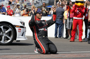 Juan Pablo Montoya, of Colombia, celebrates after winning the 99th running of the Indianapolis 500 auto race at Indianapolis Motor Speedway in Indianapolis, Sunday, May 24, 2015.  (AP Photo/Sam Riche)