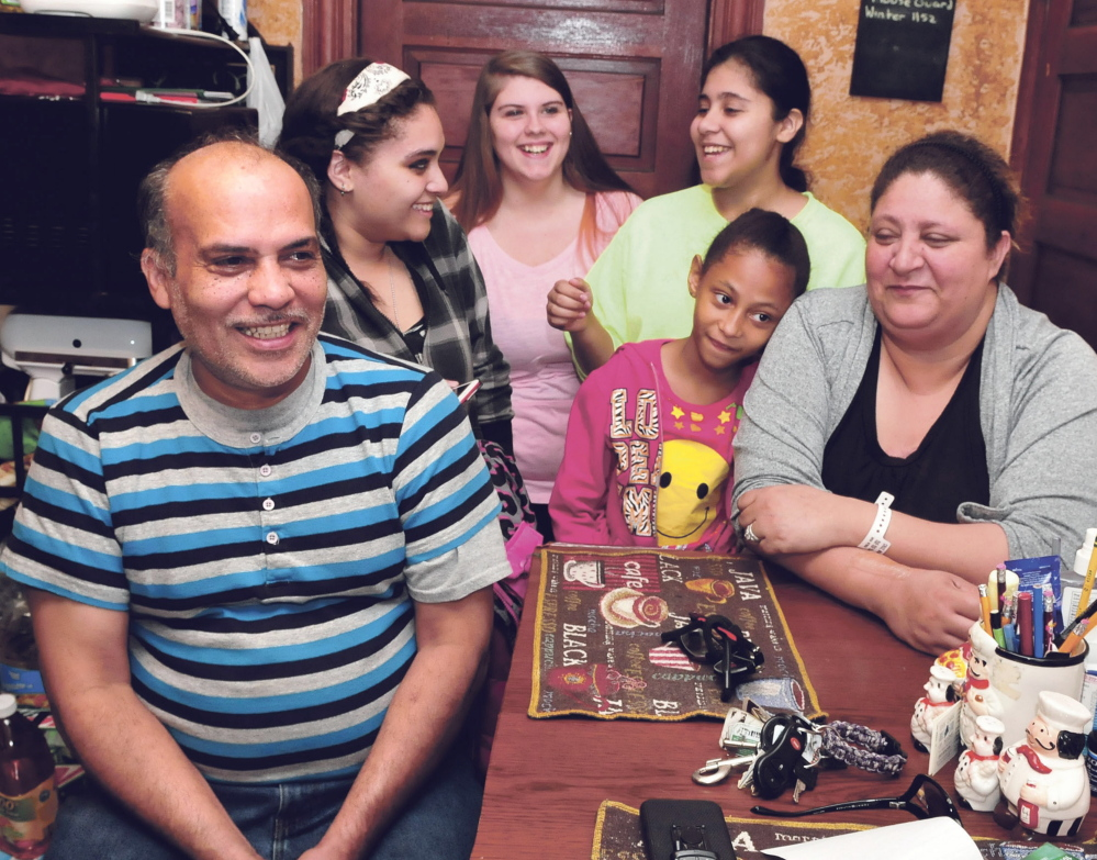 Florentino Santiago, of Winslow, will get a high school diploma Tuesday after completing courses with the Mid-Maine Regional Adult Education program. He and his wife, Mary, have six children and are seen here with daughter Crystal, left, family friend Jericha, daughter Carmen and granddaughter Niesha in front.