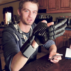 Nick Stafford, of Athens, wears the prosthesis he now uses since his right hand was seriously damaged in a mill accident.