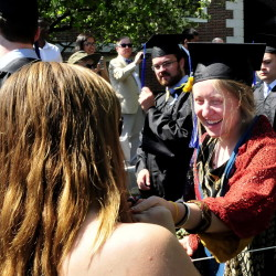 Colby College graduate Sydney Morison, right, is congratulated by fellow student Grace Fowler during the procession prior to commencement in Waterville on Sunday.