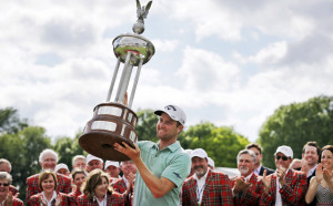 Chris Kirk lifts the trophy Sunday after winning the Colonial in Fort Worth, Texas.
