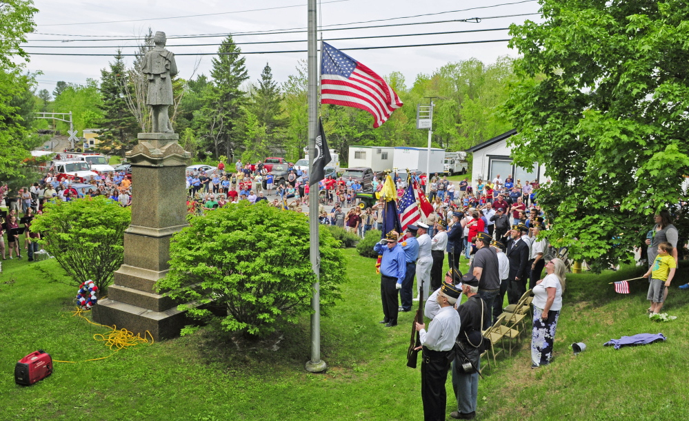 People attend Memorial Day ceremonies at the Civil War monument in downtown Monmouth on Monday.
